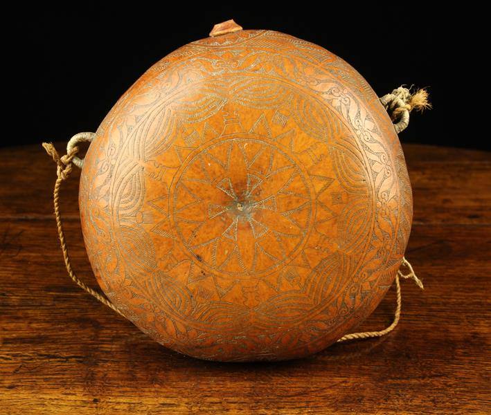 A Gourd Pilgrim Flask of round cushion form engraved with intricate decoration and having a small - Image 4 of 4