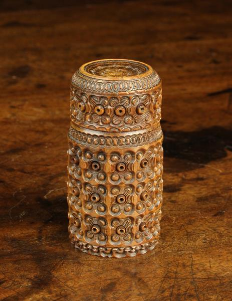 A 19th Century Carved Cocquilla Nut Shaker.