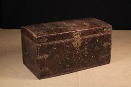 A Large & Impressive Queen Anne Leather Clad Travelling Trunk adorned with decorative brass