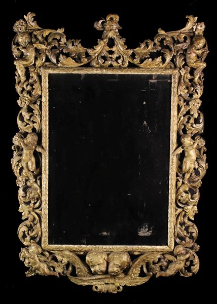 A Charles II Carved Giltwood Wall Mirror.