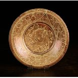 A Small Hispano-Moresque Plate decorated with lustre glaze with a bird to the centre in a scroll