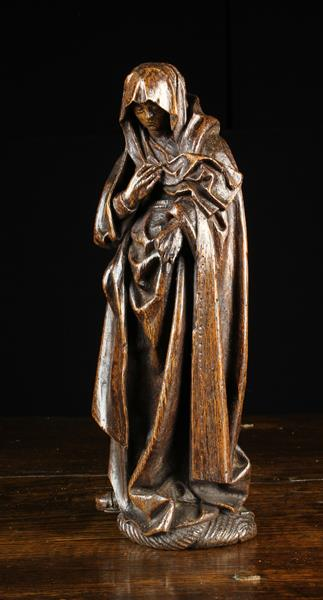 A Small 15th/Early 16th Century Oak Carving of Mary Magdalene;