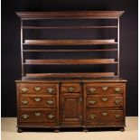 A Large 18th Century Oak Enclosed Dresser with Rack (A/F).