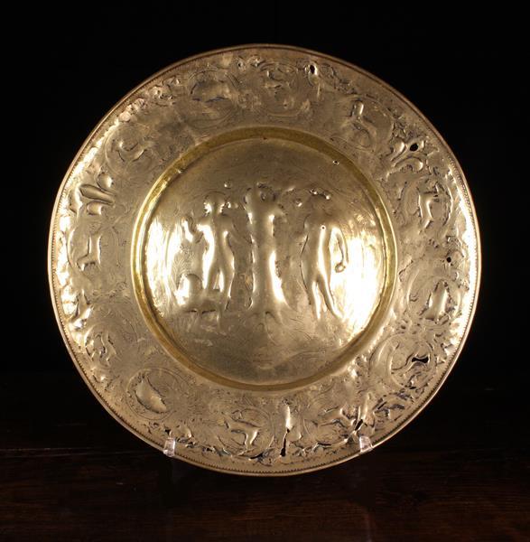 A Large 17th Century Repoussé Brass Alm Dish (A/F).