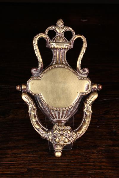 A Fine Antique Brass Door Knocker surmounted by an urn shaped finial;