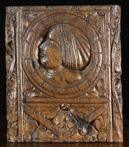 A 16th Century Oak Pew End Section.