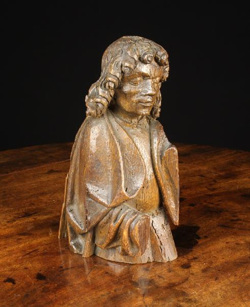 """An Early 16th Century Oak Bust of St John from a retable group, marked with the """"hand"""" of St."""