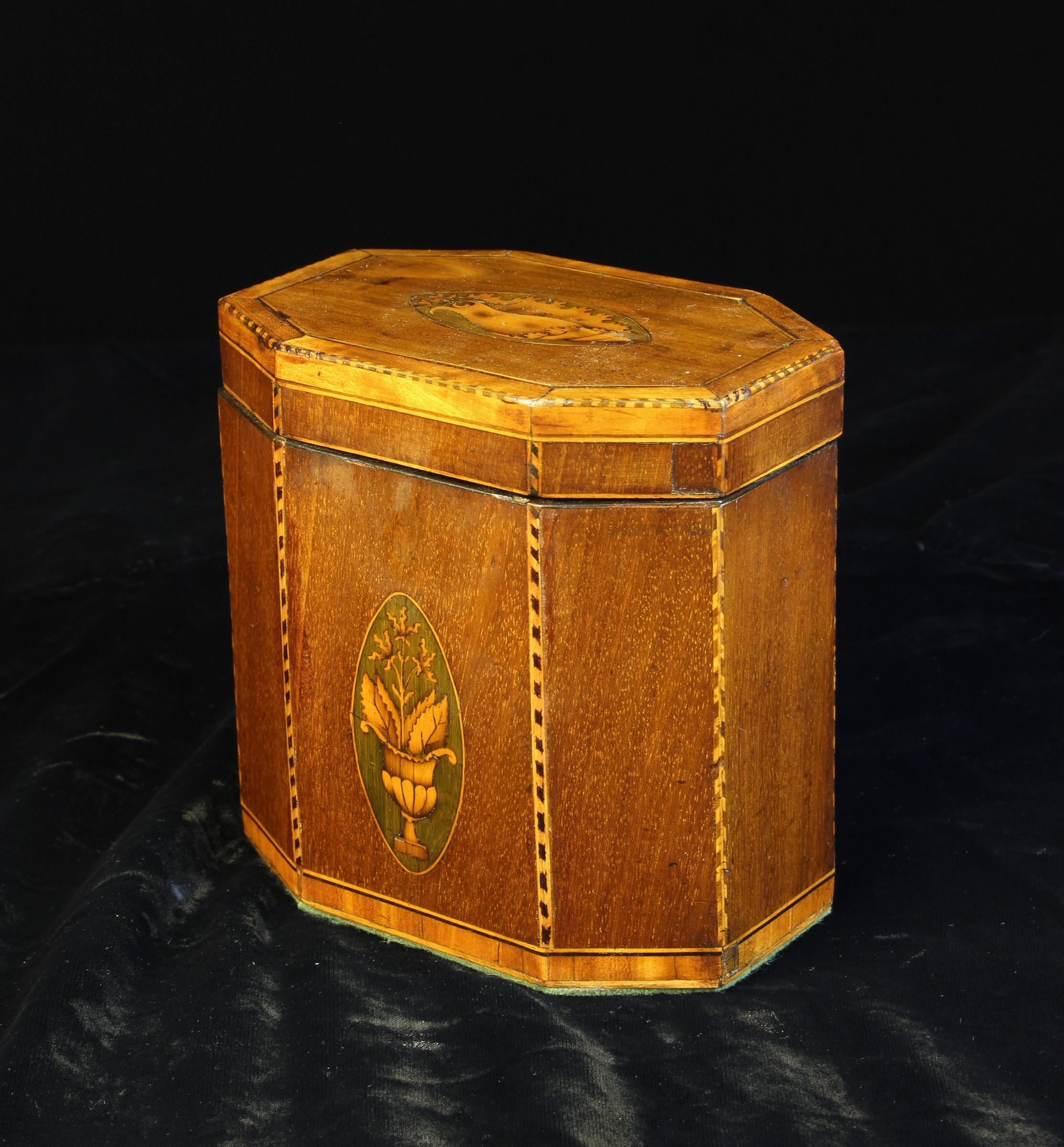 A George III Mahogany & Satinwood-banded Tea Caddy of octagonal form.