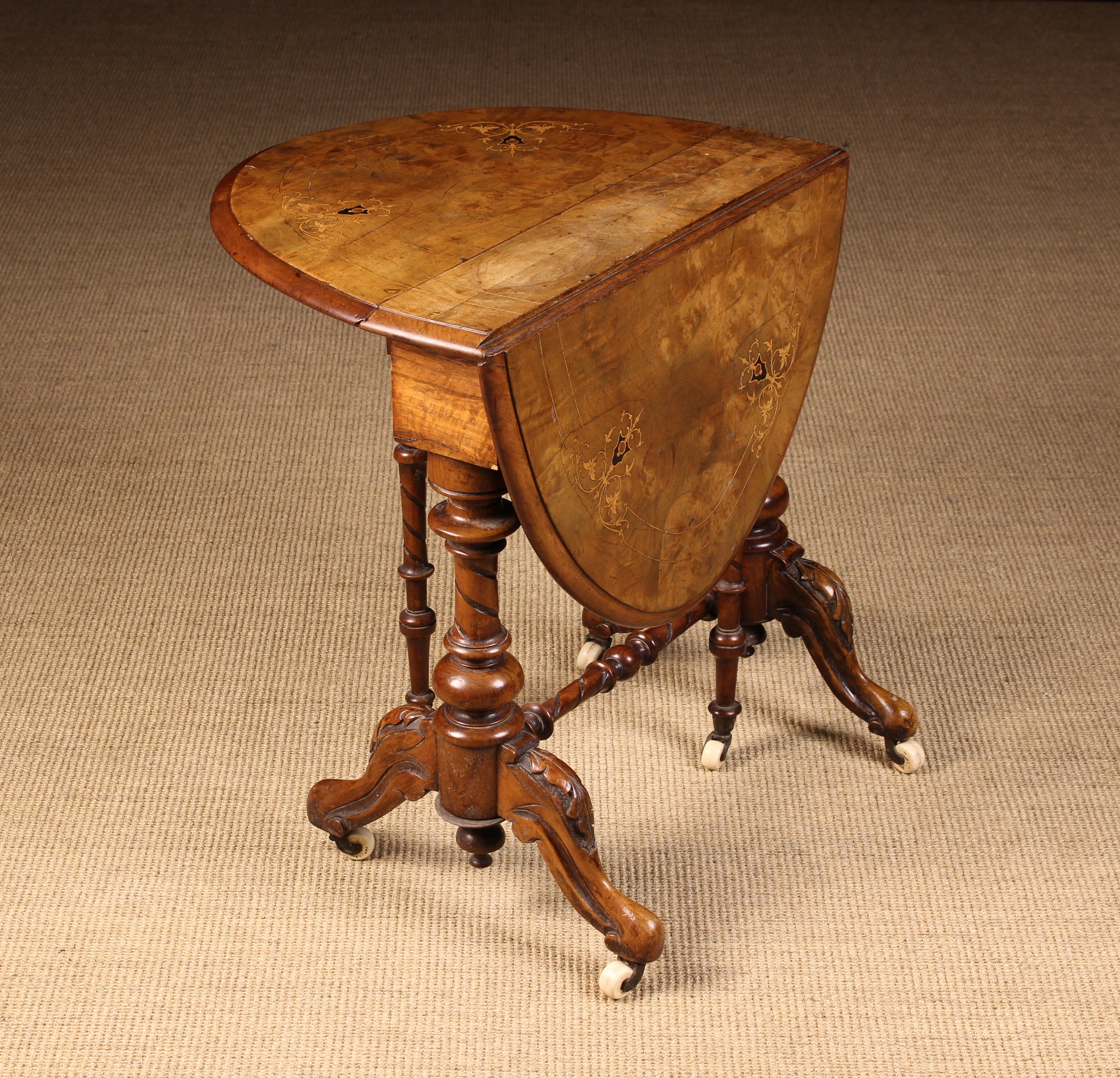 A Small Victorian Figured Walnut Sutherland Table.