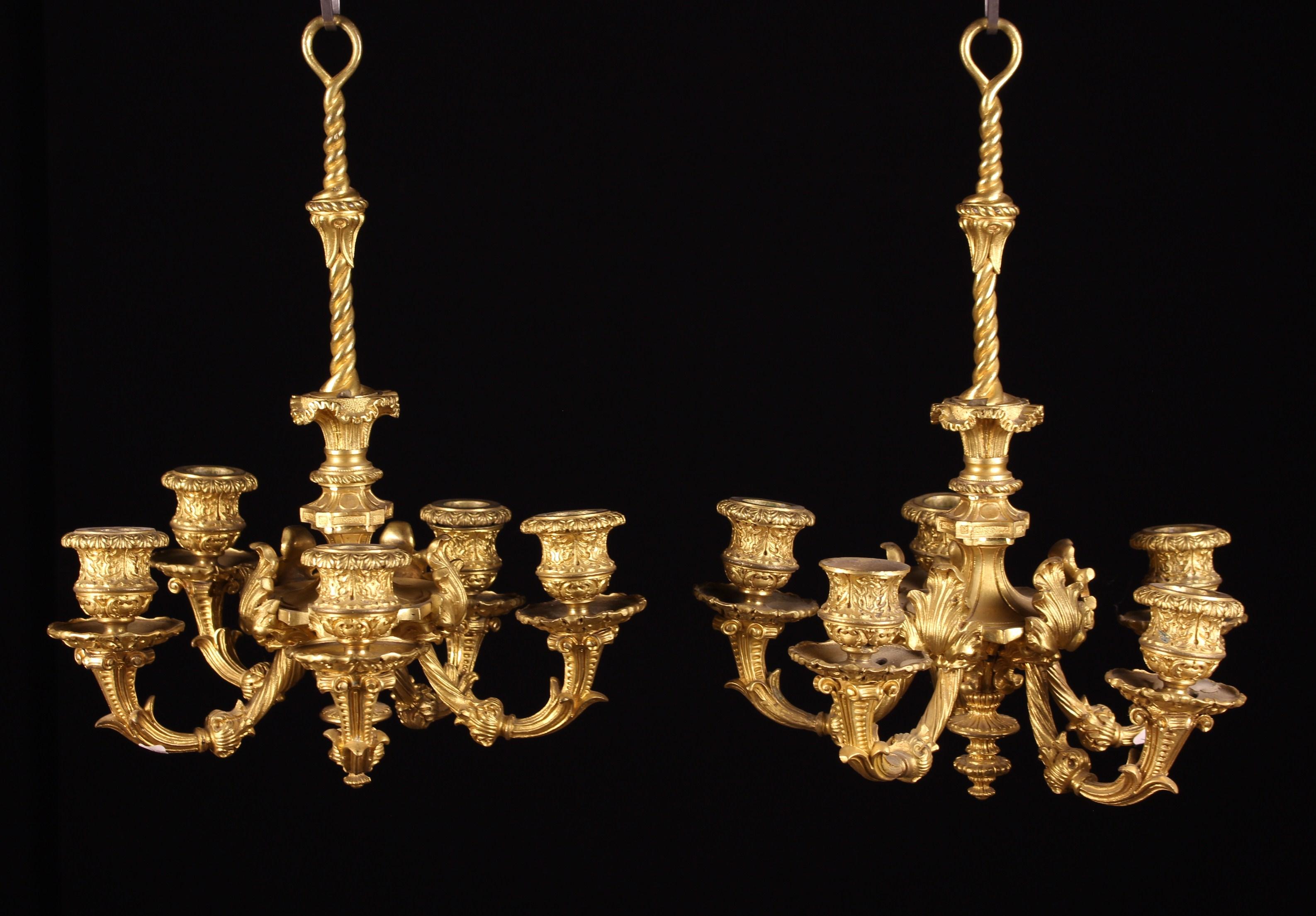 A Fine Pair of Small Louis XVI Ormolu Chandeliers.