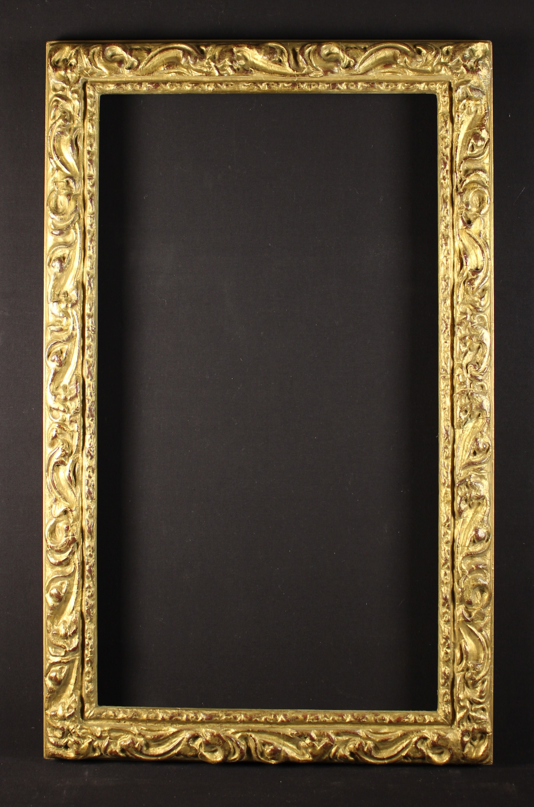 """A 19th Century Italianate Giltwood Frame carved with swirls of stylised foliage and measuring 42¼"""""""