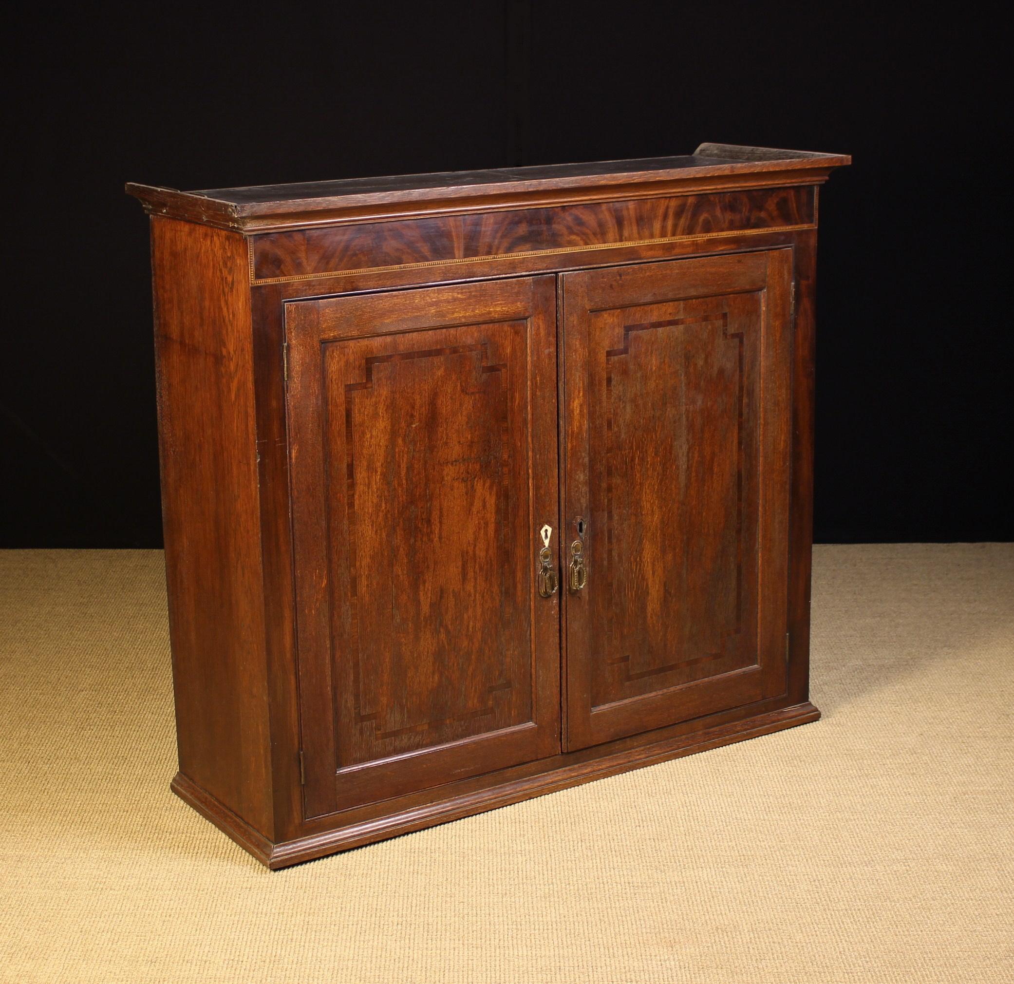 A Georgian Inlaid Oak Bookcase.