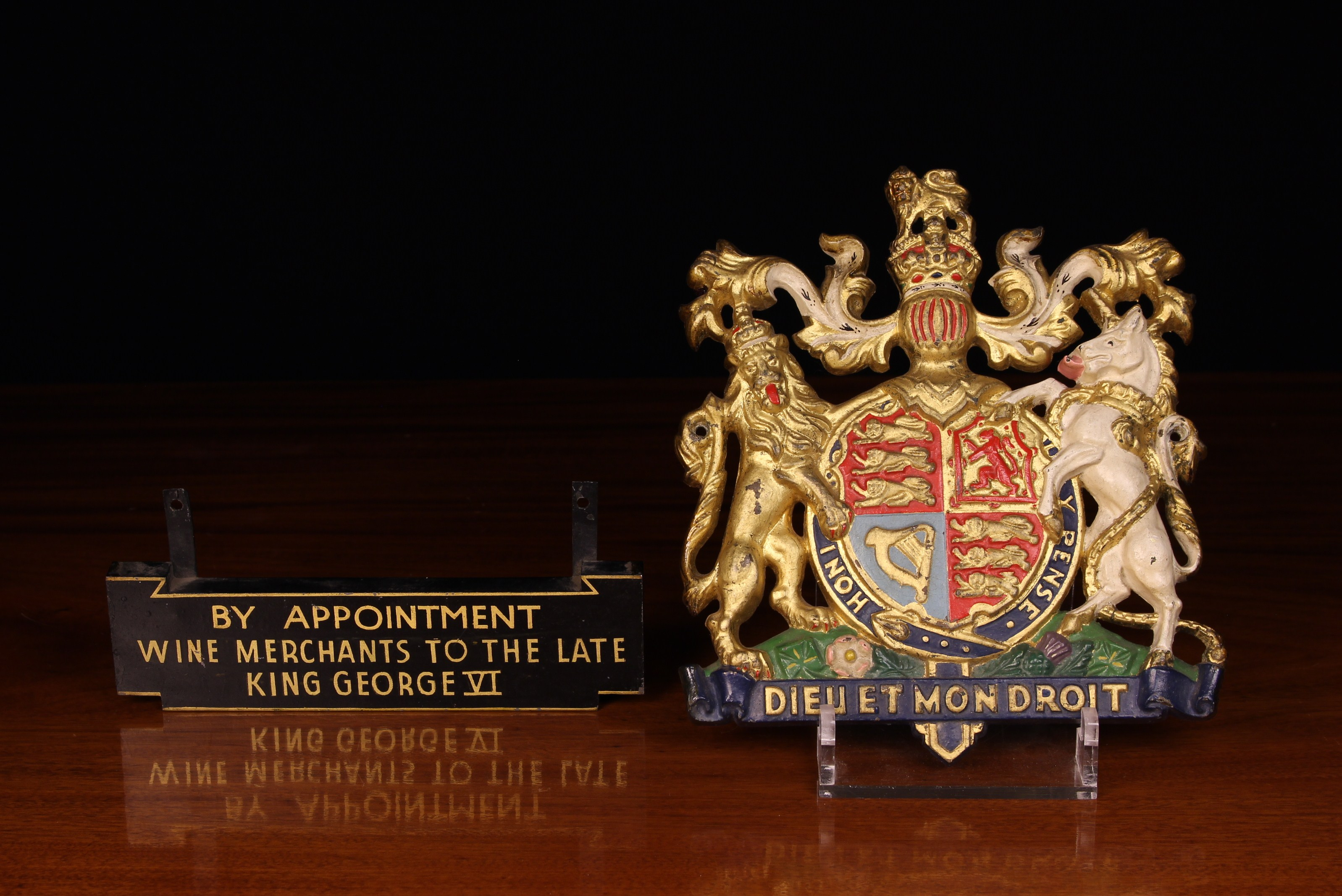 A Cast Metal Royal Crest enriched with vibrant polychrome paint-work and gilding with attached