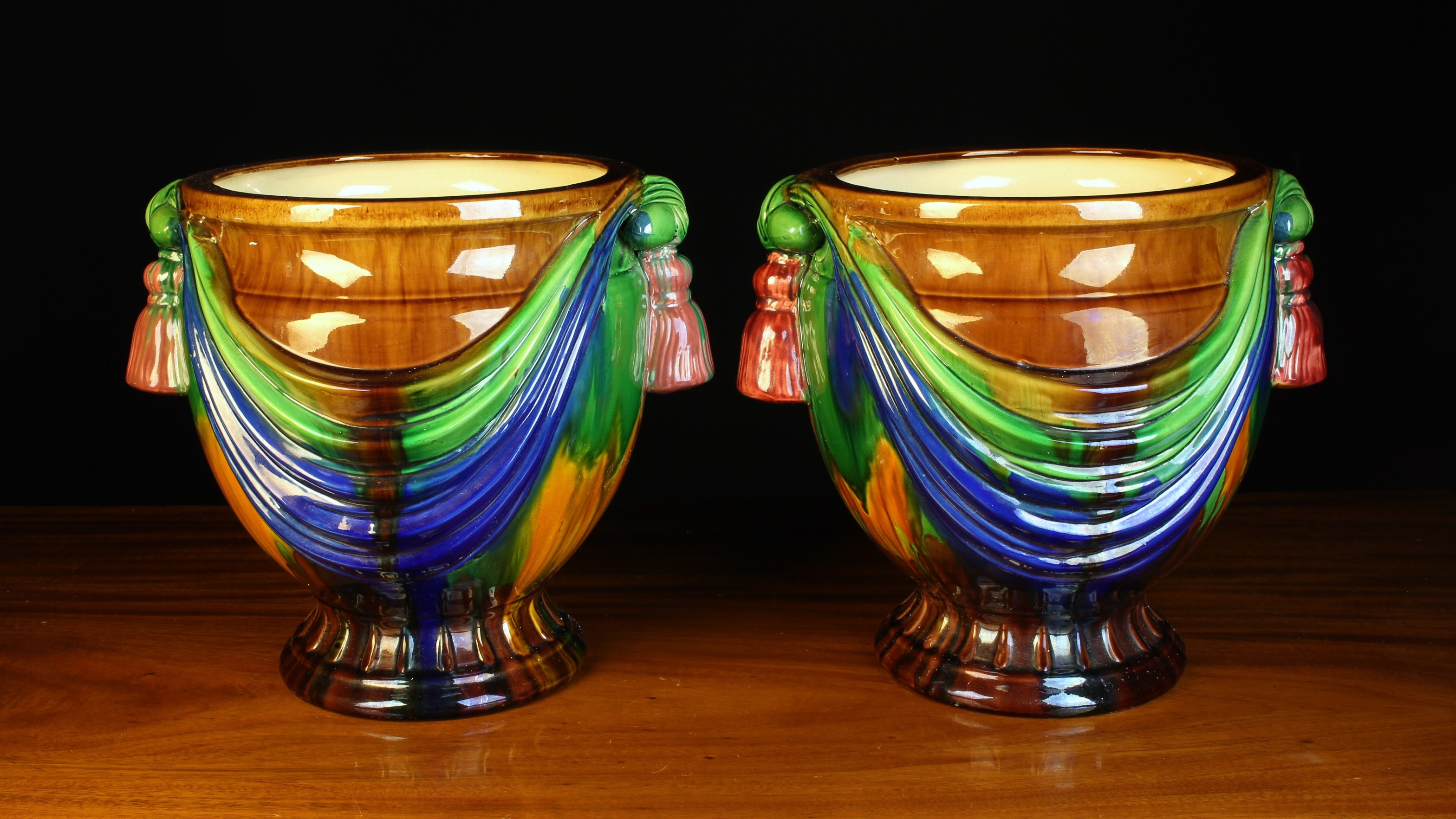 A Pair of Vintage Majolica Jardinieres moulded with swagged drapery between pendant tassels either
