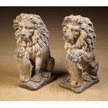 A Pair of Composite Stone Architectural Lions Sejant.
