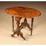 A Small Victorian Figured-Walnut Sutherland Table.