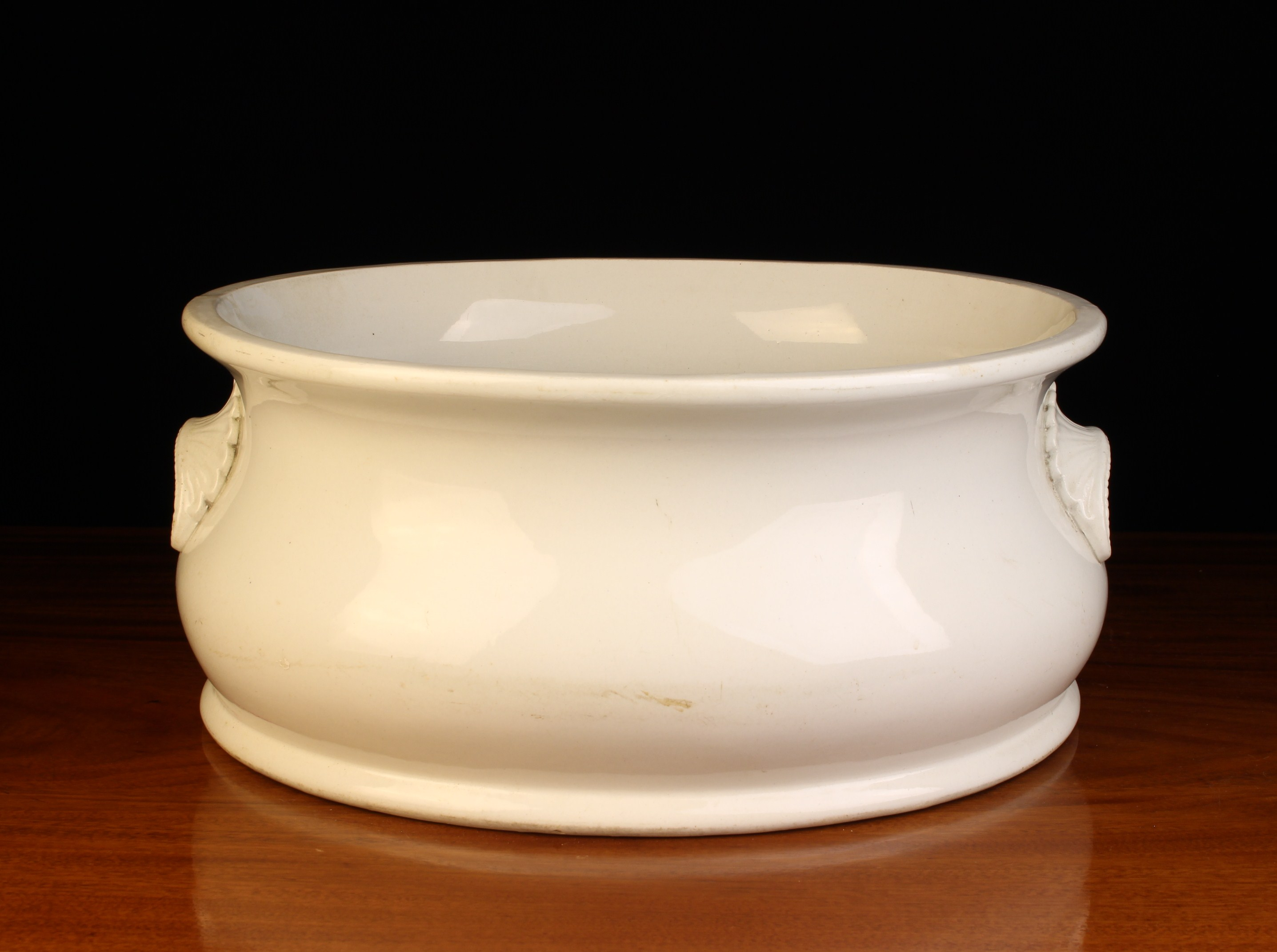A 19th Century White Glazed Belleek Pottery Foot Bath with decorative moulded lip handles either