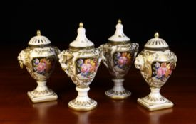 Two Pairs of Small 19th Century Style Ornamental Porcelain Urns decorated with floral panels
