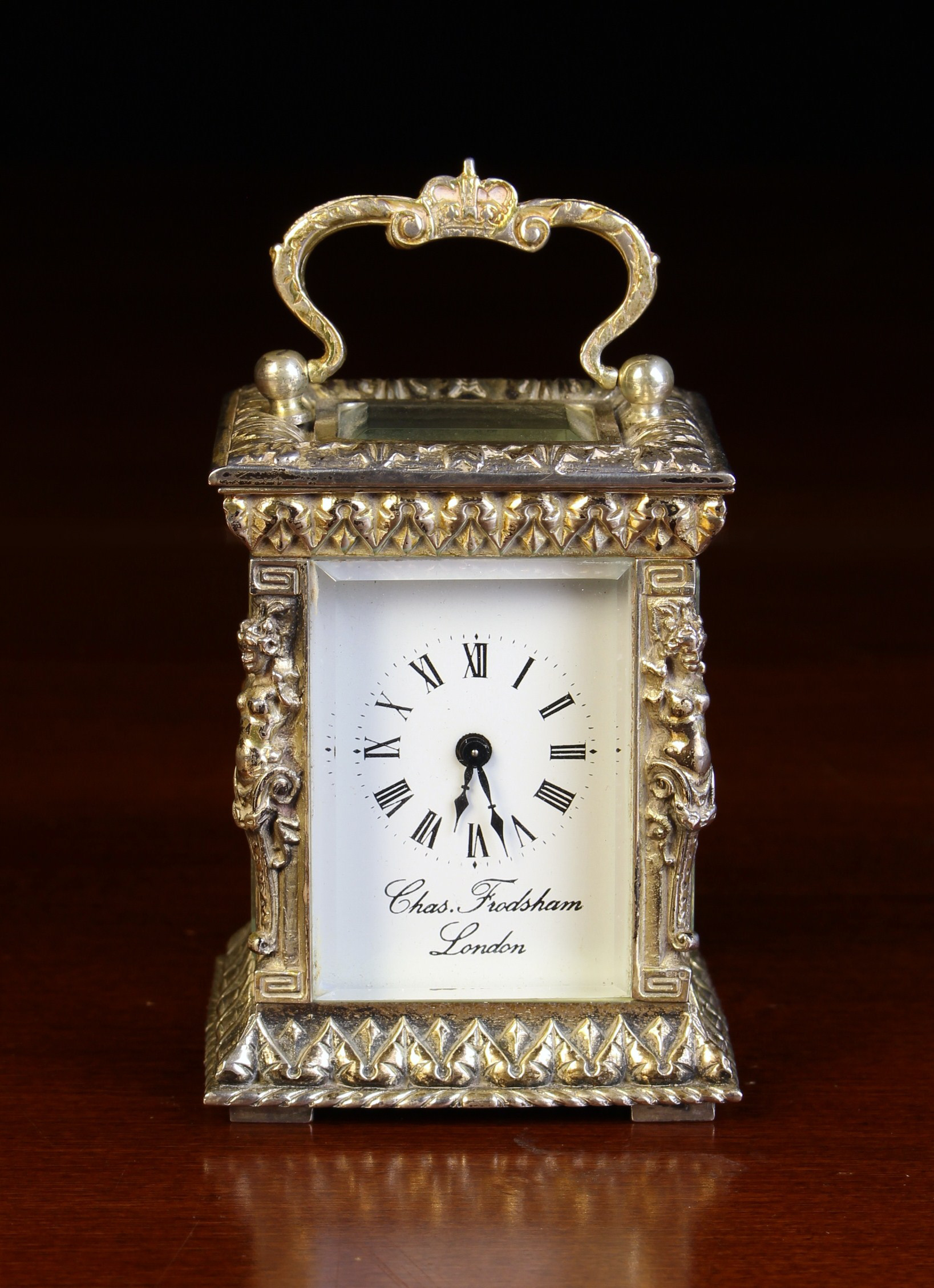 A Miniature Silver Cased Carriage Clock by Chas. Frodsham, London.