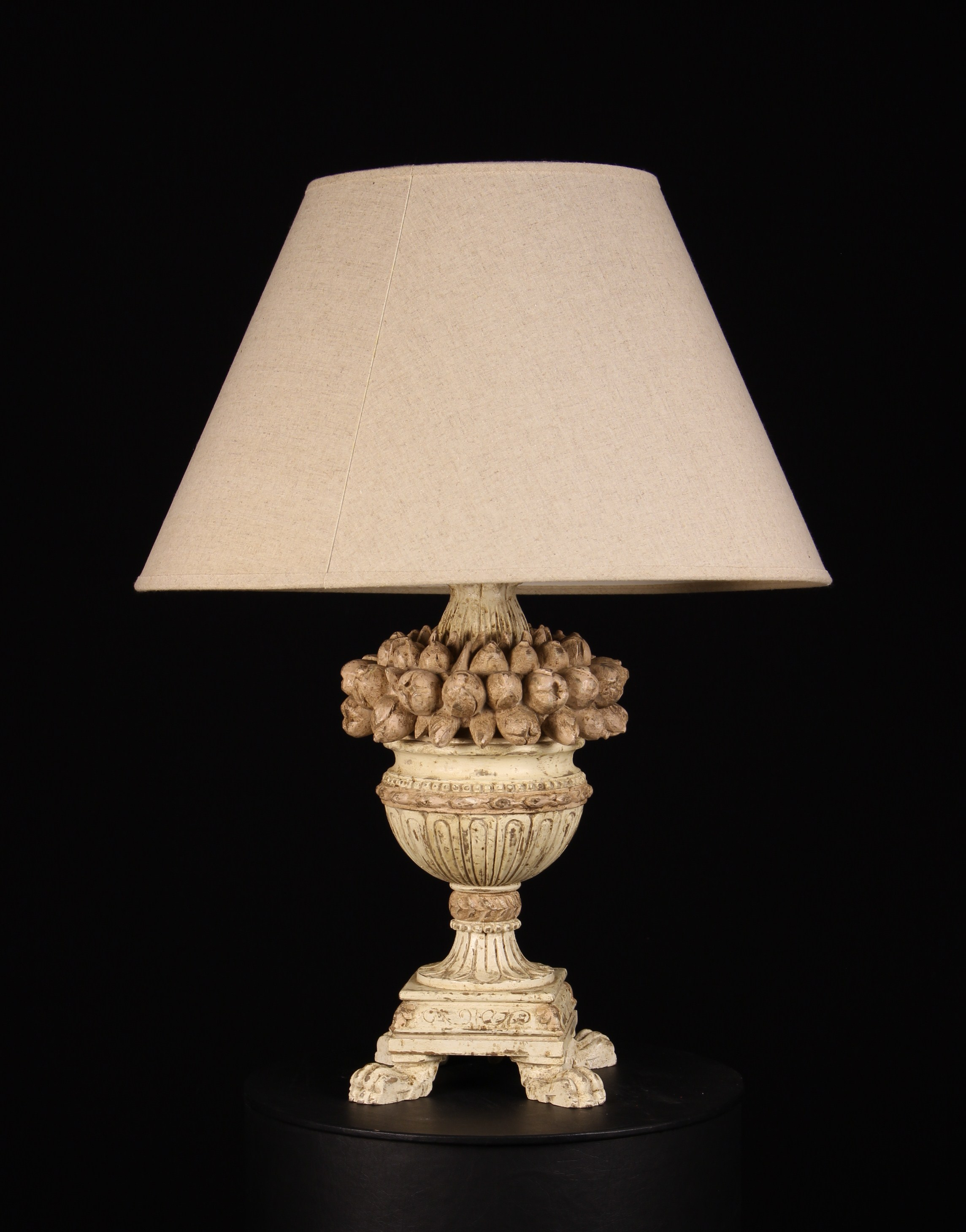A Decorative Wooden Table Lamp with distressed white paint-work and an ecru linen shade.