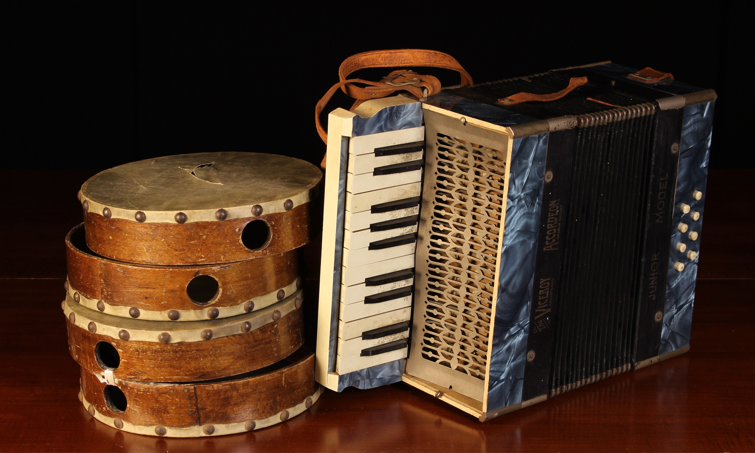 A Vintage Accordion; 'The Viceroy' Junior model, made in Saxony, and four vintage tambourines (A/F).