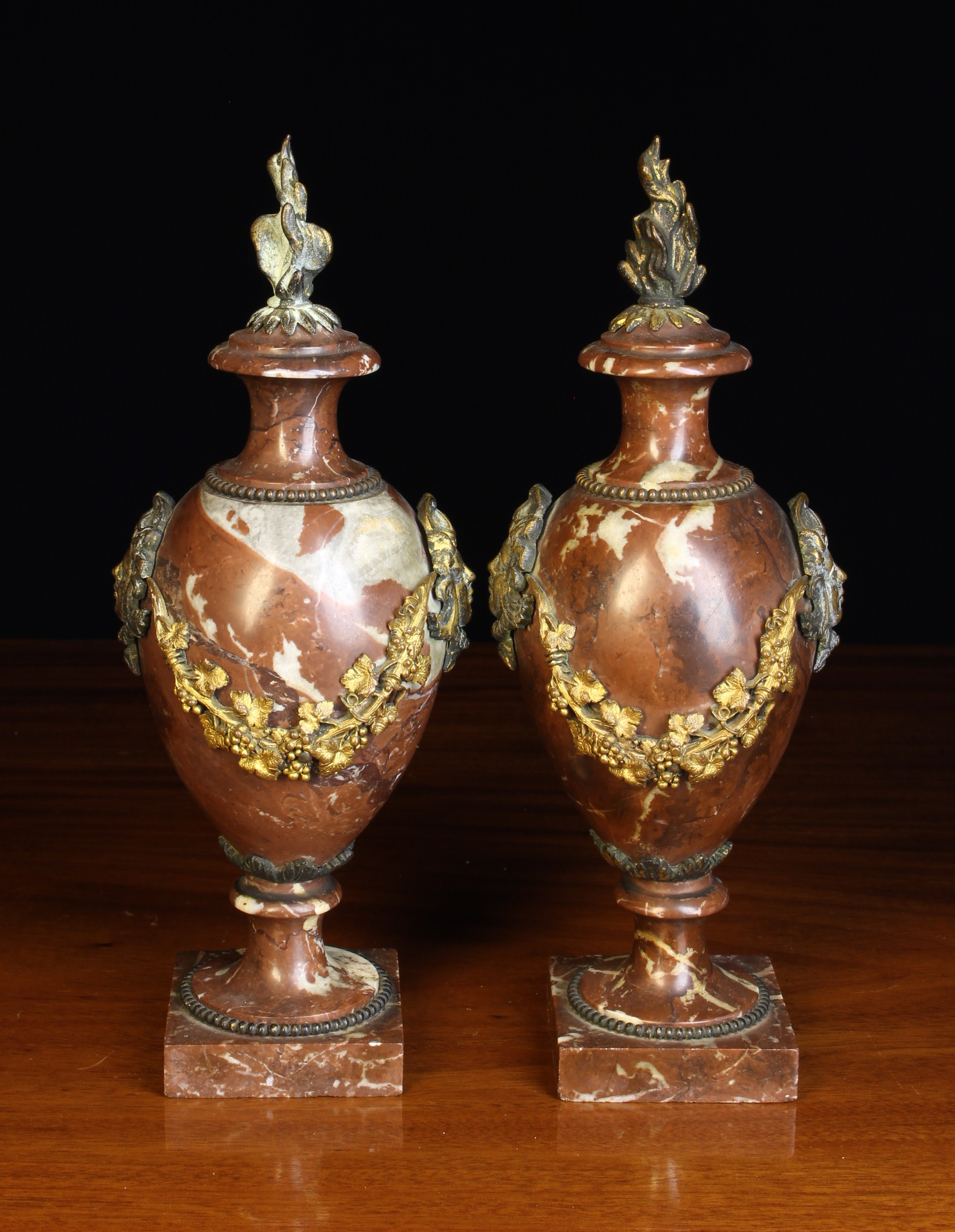 A Pair of Small 19th Century Rouge Marble Cassolettes with gilt metal mounts.