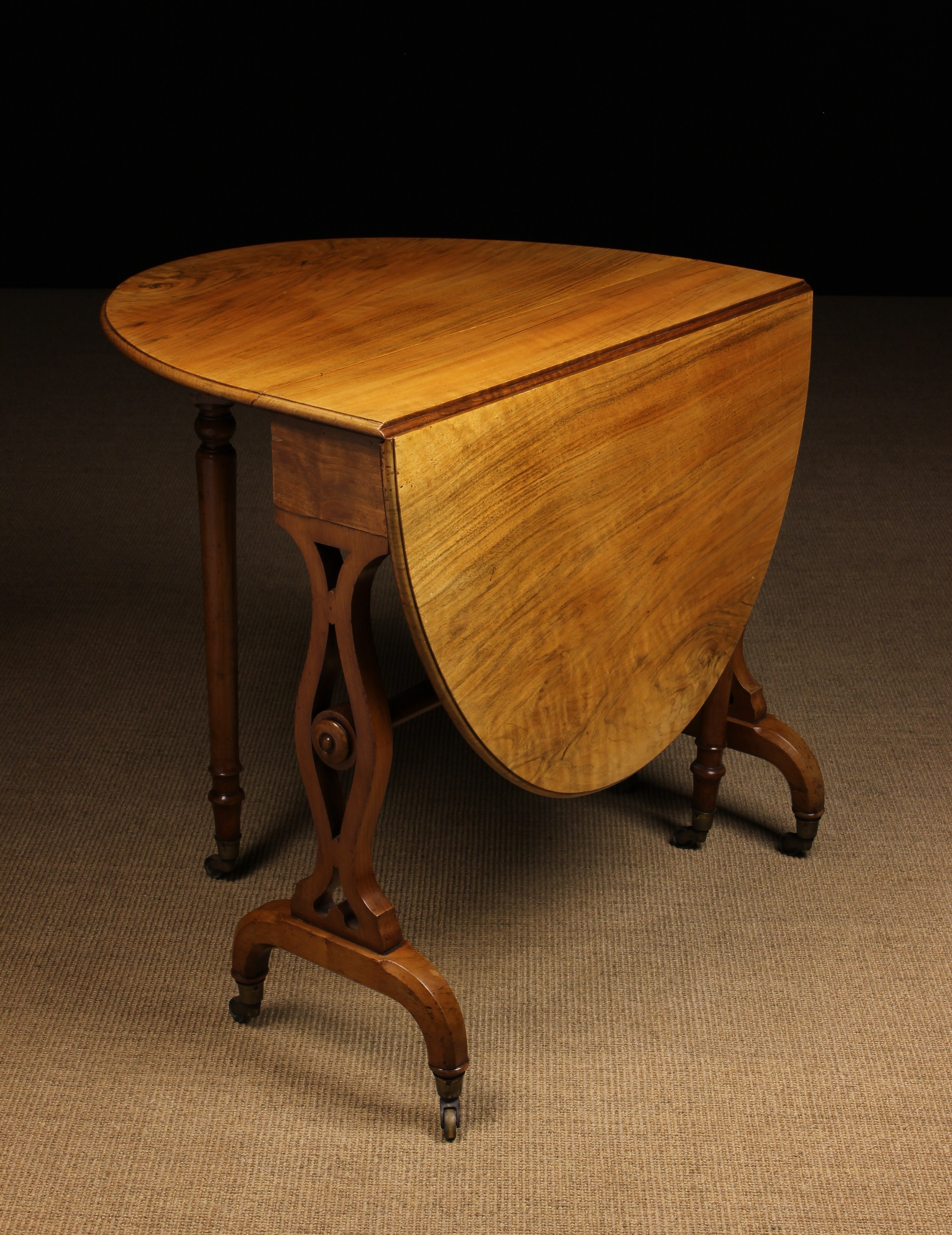 A Fine Early Victorian Holland & Sons Walnut Sutherland Table.