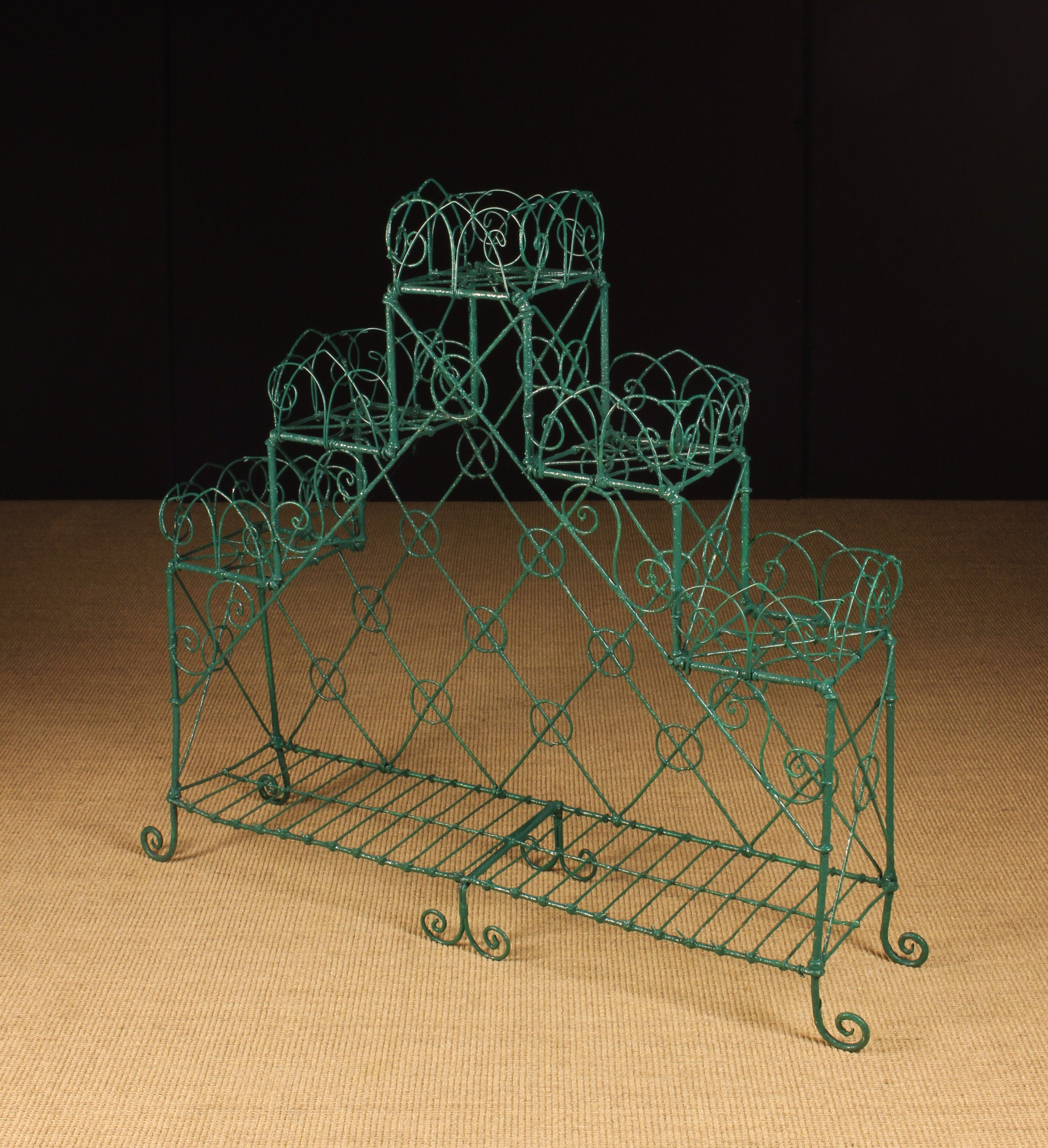 A 19th Century Wirework Plant Stand, painted green.