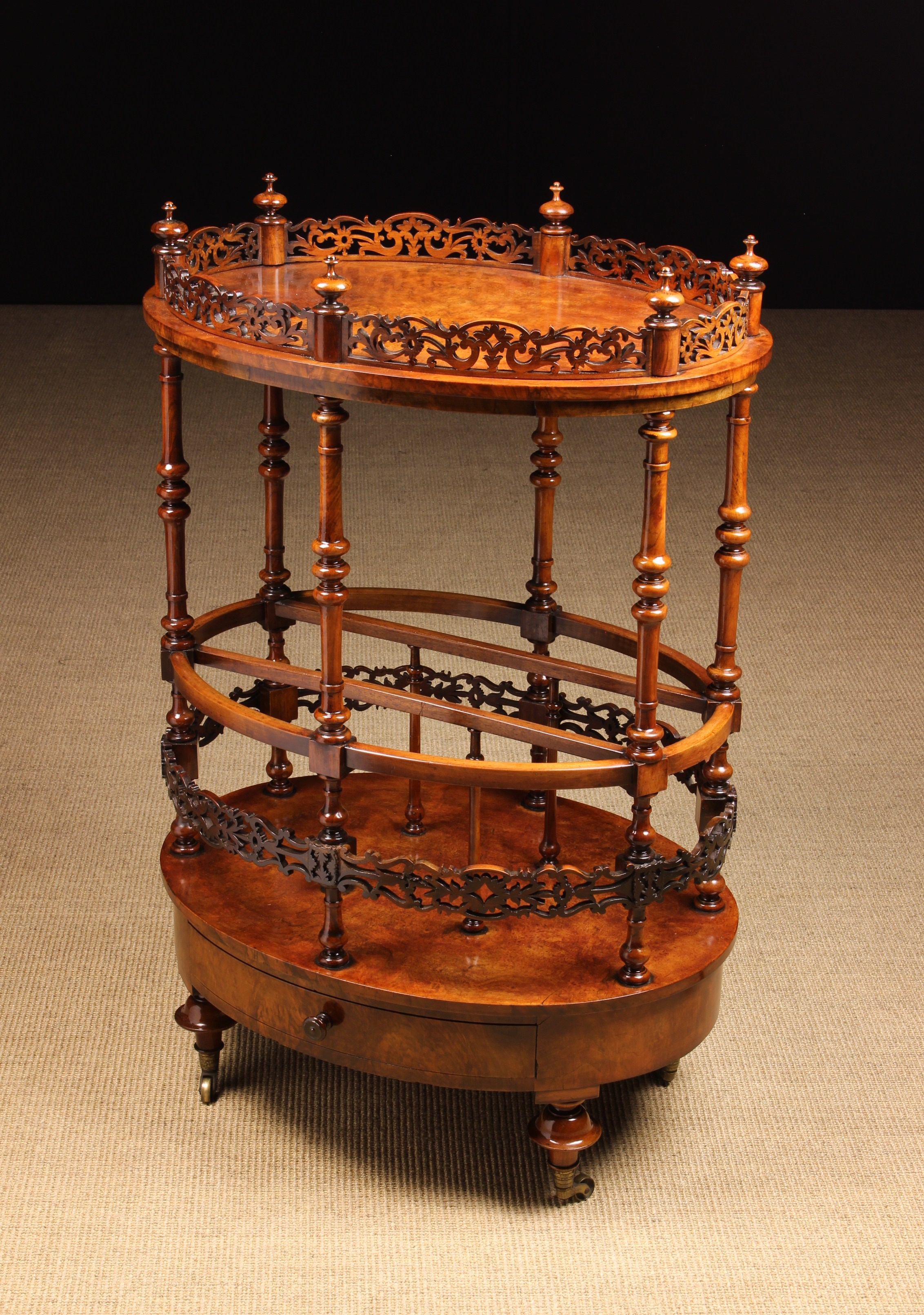 A Rare Victorian Burr Walnut Gallery-topped Canterbury Table.