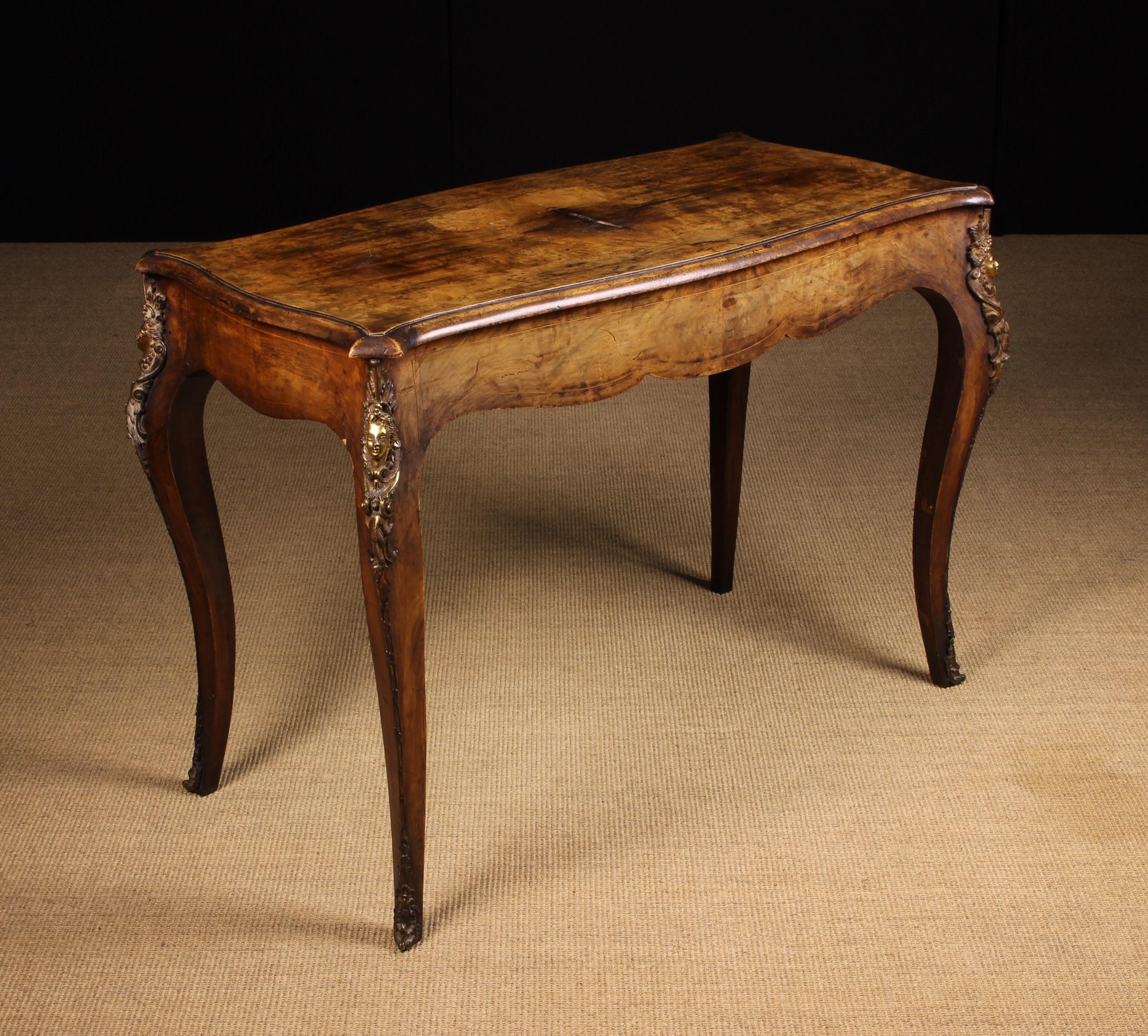 A Victorian Figured Walnut Centre Table.