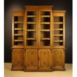 A Handsome Late Victorian Arts & Crafts Oak Break-front Library Bookcase stamped 'Garrett & Sons'