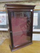 A mahogany effect wall display cabinet, 72cm tall x 46cm x 17cm