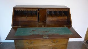 A Georgian mahogany five drawer bureau on ogee bracket feet, 110cm tall x 116cm x 55cm, with a