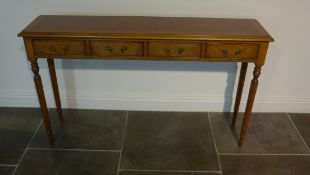 A burr wood four drawer hall/side table on turned reeded legs made by a local craftsman to a high