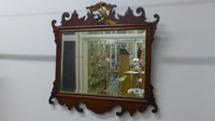 A Georgian style mahogany phoenix mounted mirror, 57cm tall x 58cm wide, with restorations
