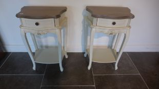 A pair of painted bedside tables each with a single drawer and under tier