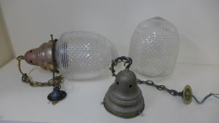 A pair of cut glass hanging ceiling lights with brass holders, 38cm long x 20cm wide, both shades