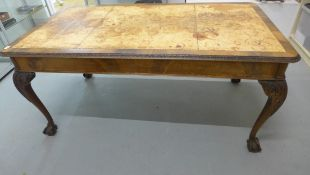A mahogany library table with a leather inset top on carved cabriole legs, 77cm tall x 166cm x 91cm,