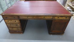 A late Victorian mahogany twin pedestal partners desk with an arrangement of 6 drawers and a