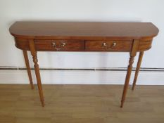 A satinwood two drawer D end side table on turned legs made by a local craftsman to a high
