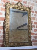 A gilt wall mirror with porcelain plaque - some gesso losses and cracking to gesso but a