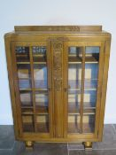 An oak two door glazed Scully display cabinet - Height 126cm x 91cm x 29cm
