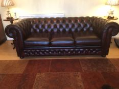 A Thomas Lloyd leather Chesterfield settee sofa bed - as new, only a few months old