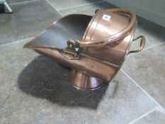 A 19th century copper coal scuttle