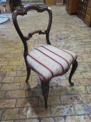 A pretty 19th century rosewood upholstered side chair on carved cabriole legs - in good overall