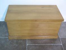 A cedar wood toy / storage chest, made by a local craftsman to a high standard, 44cm tall x 87cm x