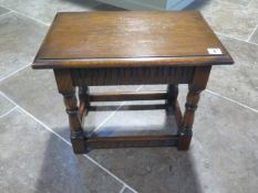 A 17th century style carved oak joined stool in polished condition - Height 42cm x 48cm x 30cm