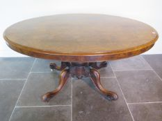 A Victorian burr walnut oval tilt top breakfast table on four scroll supports - Height 73cm x