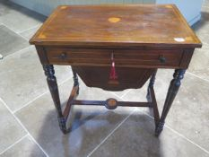A late Victorian/Edwardian work table with drawer and basket, mahogany with inlay, with some