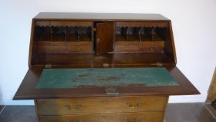 A Georgian mahogany five drawer bureau on ogee bracket feet, 110cm tall x 116cm x 55cm, with a